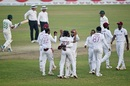 West Indies players gather around Jomel Warrican, who dismissed Mehidy Hasan Miraz to seal the visitors' series victory, Bangladesh vs West Indies, 2nd Test, Dhaka, 4th day, February 14, 2021