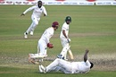 Mehidy Hasan Miraz looks on as Rahkeem Cornwall completes a diving catch in the slips to hand West Indies victory, Bangladesh vs West Indies, 2nd Test, Dhaka, 4th day, February 14, 2021