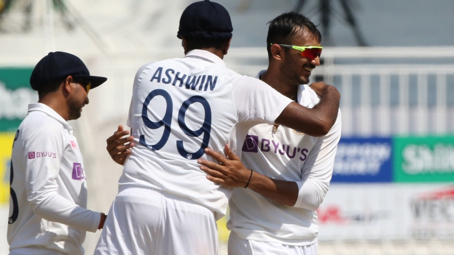Axar Patel and R Ashwin celebrate after Ollie Pope departs