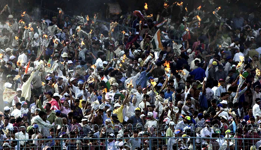 Burn after reading: spectators at Eden Gardens torch newspapers in celebration of the win