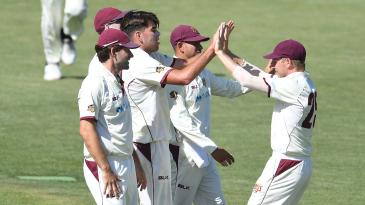 Xavier Bartlett celebrates a wicket