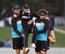 New Zealand bowling coach Jacob Oram (L) helps Lea Tahuhu off the field after she sustained a hamstring injury late in the game, New Zealand Women vs England Women, Christchurch, February 23, 2021