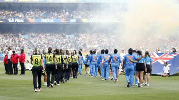 The Australia and India squads walk out for the national anthems