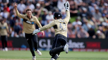 Tim Seifert takes the catch to give Mitchell Santner his third wicket in an over