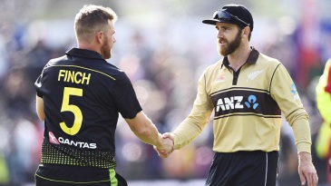 Aaron Finch and Kane Williamson shake hands after the match