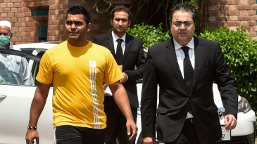 Umar Akmal with his lawyers after filing an appeal against his ban at the PCB office