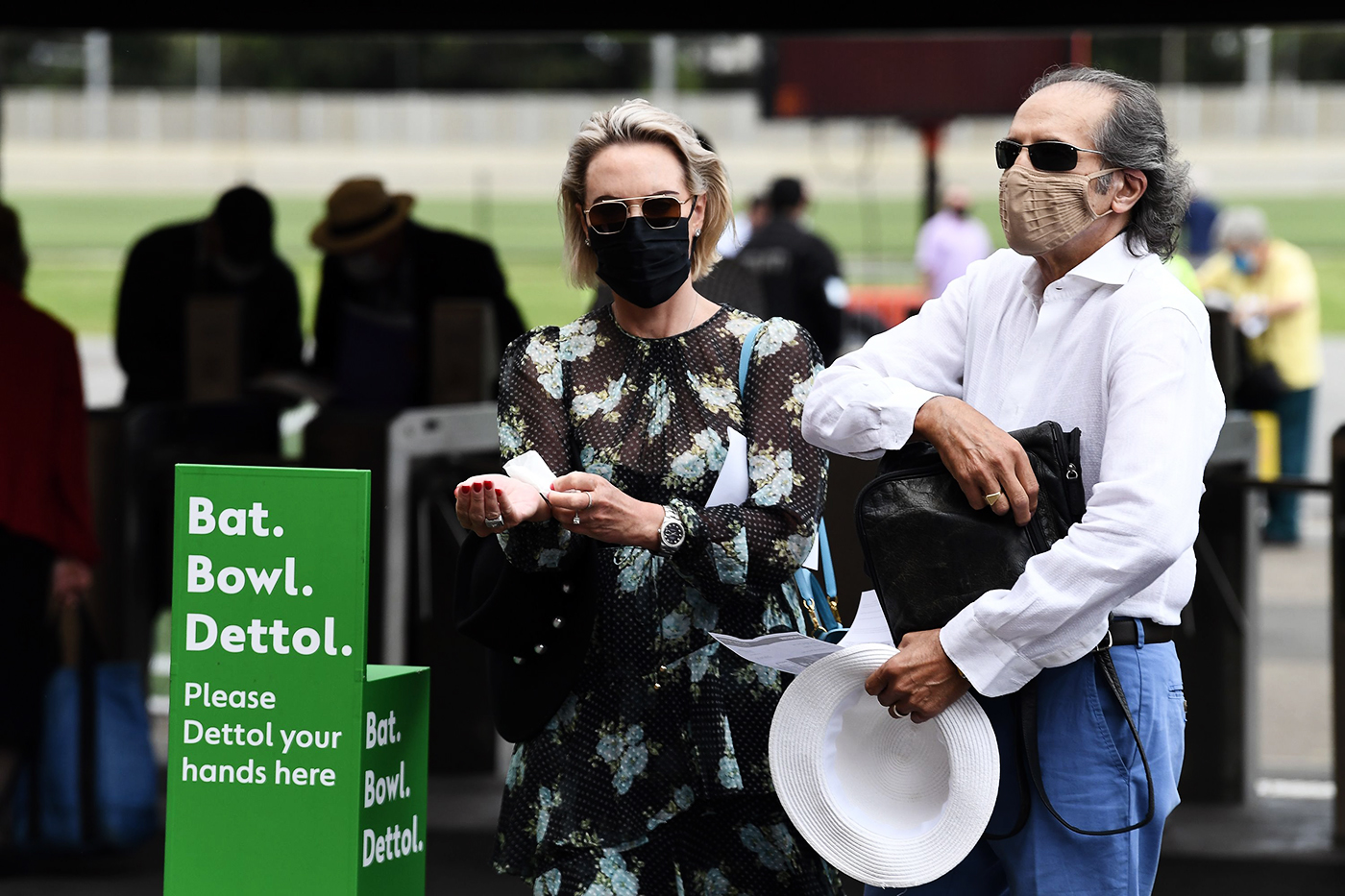 Spectators at the SCG make sure their hands are clean
