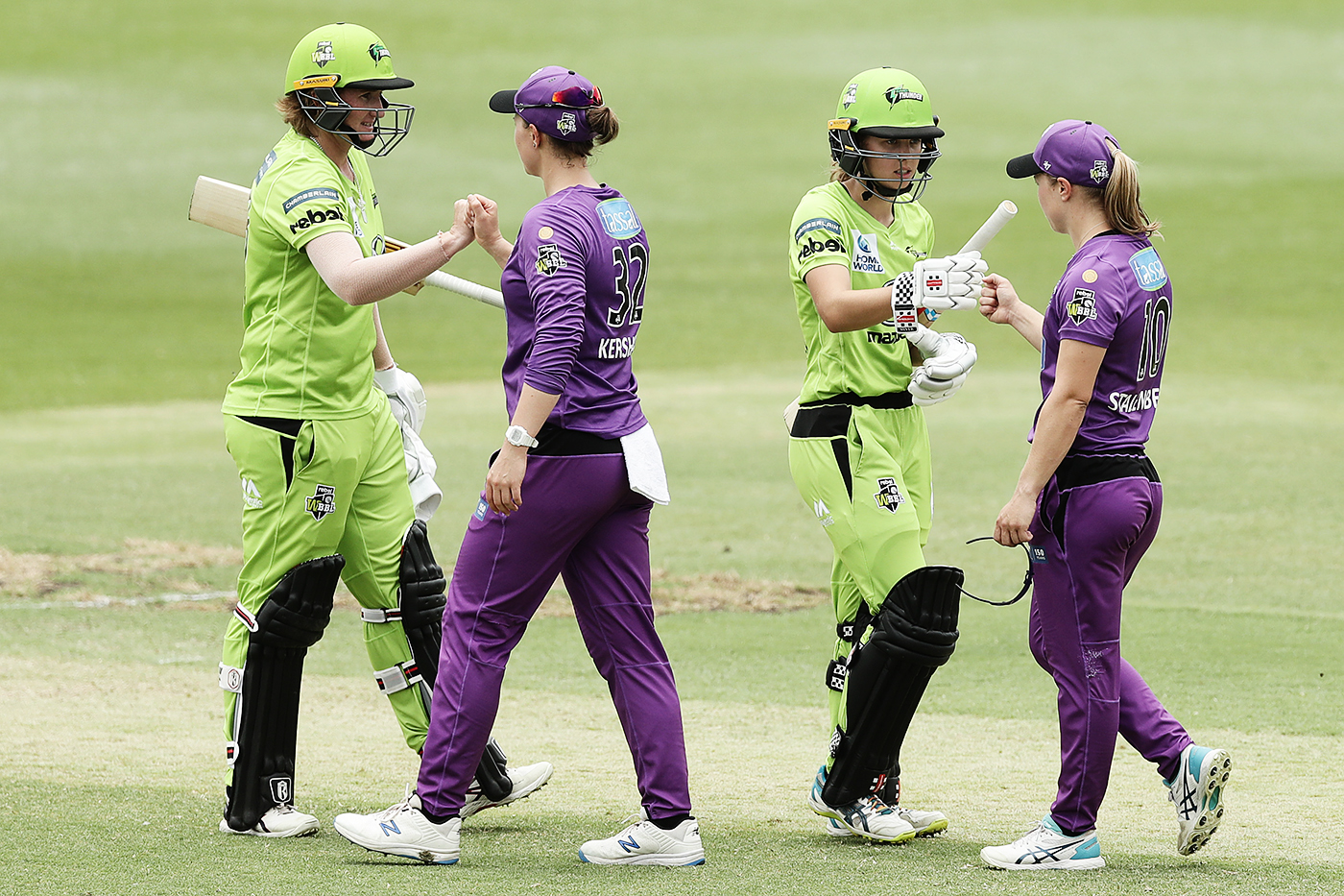 Sydney Thunder and Hobart Hurricanes' players greet each other at the end of their WBBL game