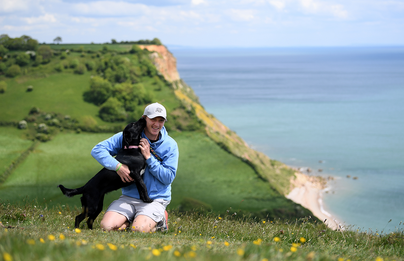 Dom Bess with his parents' dog, Tilly, in Shipton, Yorkshire