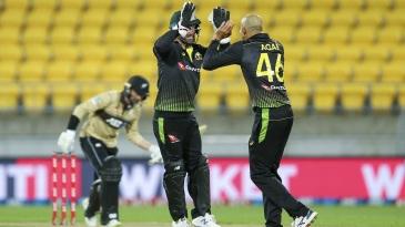 Ashton Agar celebrates the wicket of Devon Conway