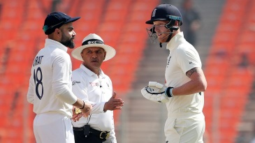 Virat Kohli and Ben Stokes exchange words during a staredown, while umpire Virender Sharma tries to keep the peace