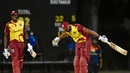 Kieron Pollard soaks in the applause after hitting six sixes in an over as Jason Holder looks on, West Indies vs Sri Lanka, 1st T20I, Coolidge, March 3, 2021