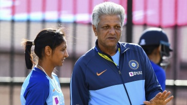 Harmanpreet Kaur and WV Raman during a training session