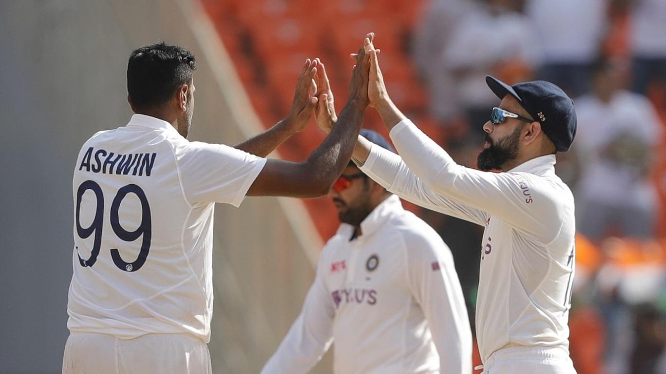 Virat Kohli and R Ashwin celebrate after the last England wicket