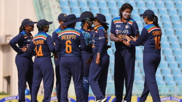 Jhulan Goswami and her team-mates celebrate a wicket