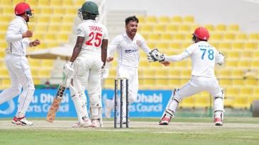 Rashid Khan celebrates after dismissing Donald Tiripano