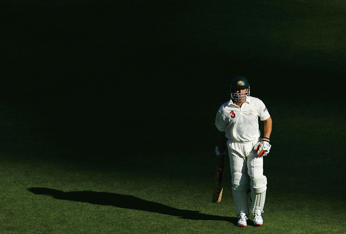 Adam Gilchrist walks out to bat