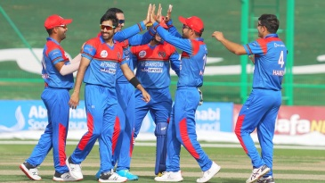 The Afghanistan players celebrate a wicket