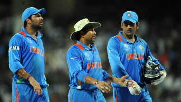 MS Dhoni, Sachin Tendulkar and Yuvraj Singh walk back to pavillion after the victory over West Indies