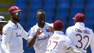 Kemar Roach celebrates with his teammates