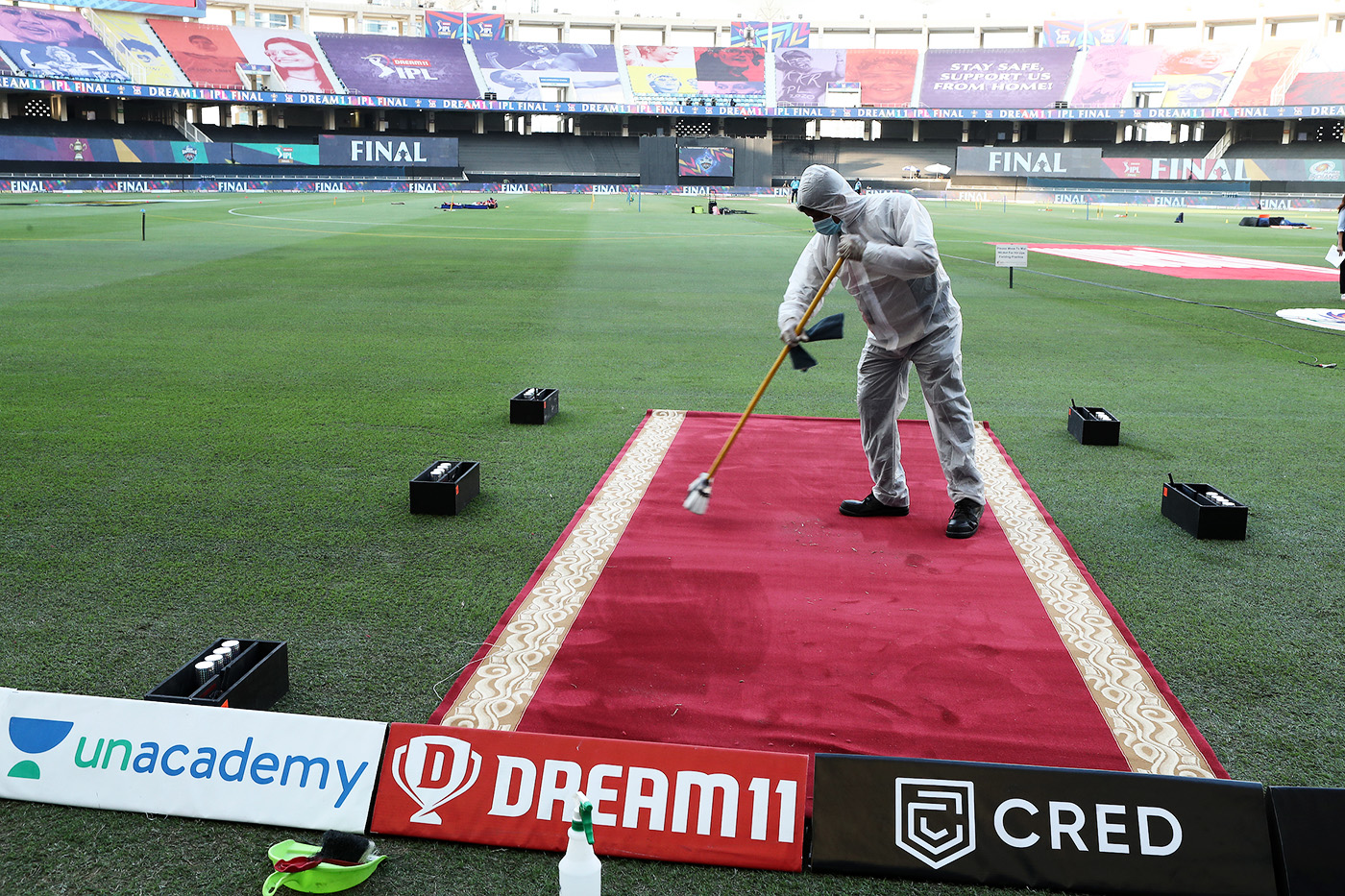 A red carpet at the entrance to the ground is sanitised