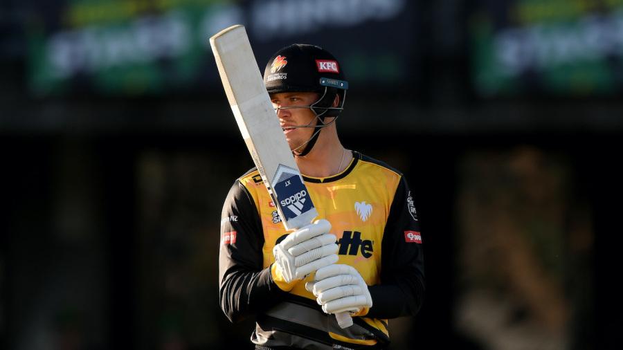 Finn Allen holds his bat up