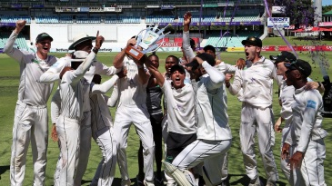 The triumphant Dolphins team hold their trophy aloft