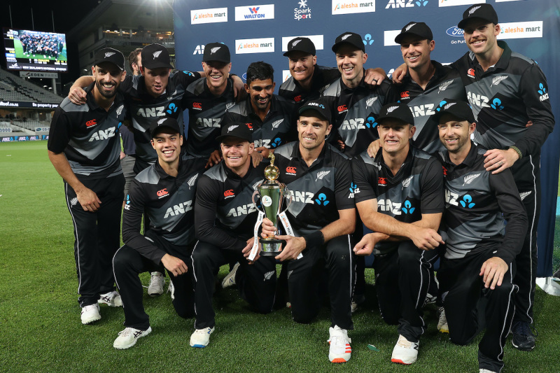 Tim Southee poses with the trophy and his team-mates