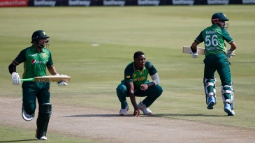 Imam-ul-Haq and Babar Azam run between the wickets as Lungi Ngidi, down on his haunches, looks on
