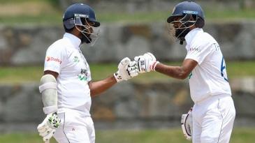 Dimuth Karunaratne and Lahiru Thirimanne bump fists during their partnership