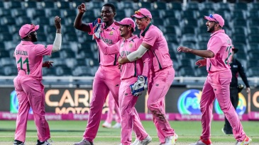 Quinton de Kock is congratulated by his team-mates after the Fakhar Zaman run-out