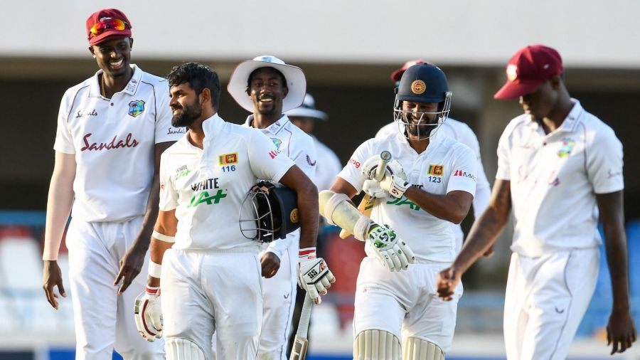 Jason Holder, Lahiru Thirimanne, and Dinesh Chandimal joke together as they leave the field