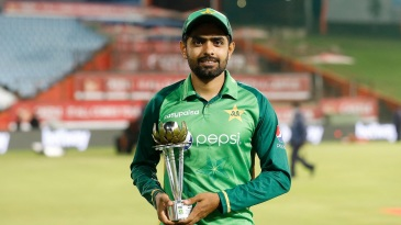 Babar Azam poses with the series trophy