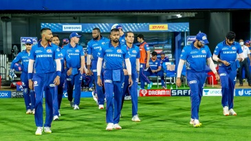 The Mumbai Indians players walk onto the field