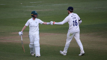 Jake Libby and Sam Cook punch gloves at the end of Worcestershire's innings