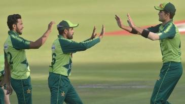 Hasan Ali, Babar Azam and Shaheen Afridi celebrate a wicket