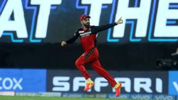 Virat Kohli points to the RCB box after taking a catch