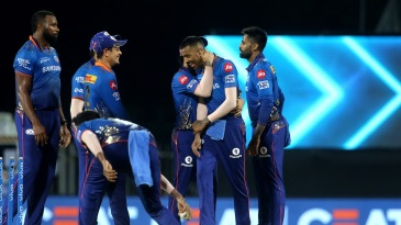 The Mumbai Indians players celebrate with Hardik Pandya, who effected two run-outs