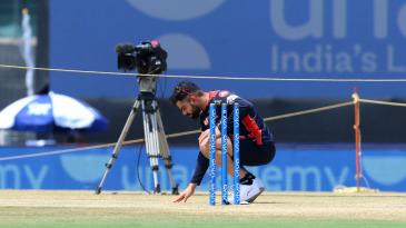 Virat Kohli examines the Chepauk pitch before the start of the match