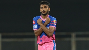 Chetan Sakariya gestures while celebrating a wicket