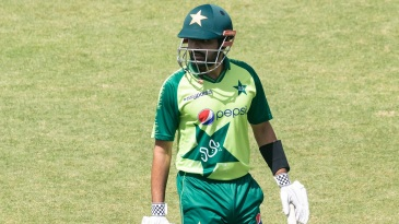 Babar Azam walks off the pitch after being dismissed by Blessing Muzarabani