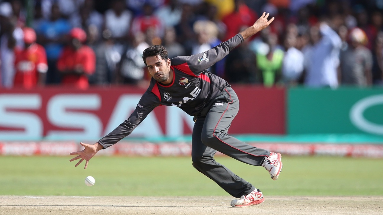 Qadeer Ahmed fields off his own bowling