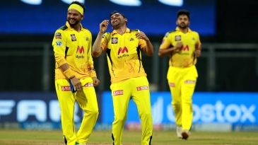 Deepak Chahar - who picked up 4 for 29 - shares a laugh with Suresh Raina