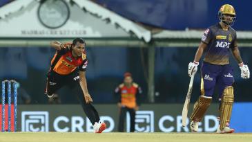T Natarajan bowls as Nitish Rana looks on