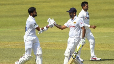 Lahiru Thirimanne is congratulated by his captain Dimuth Karunaratne on reaching a half-century