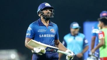 Rohit Sharma walks back after being dismissed