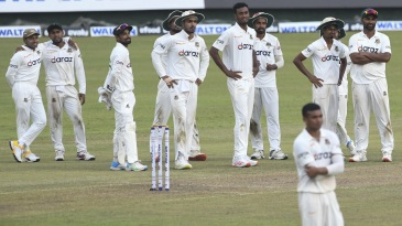 Bangladesh players await a DRS decision