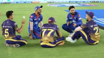 Players from both sides - Axar Patel, Rishabh Pant, Nitish Rana, Shubman Gill and Kamlesh Nagarkoti - have a chat after the game