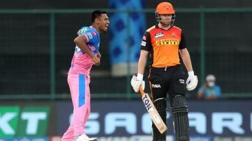Mustafizur Rahman celebrates a wicket as Jonny Bairstow looks on