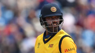 Thisara Perera walks back to the pavilion after losing his wicket for two runs